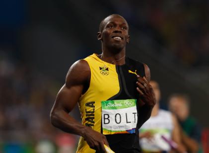 imagem do atleta usain bolt correndo e comemorando